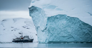 ship in front of an iceberg